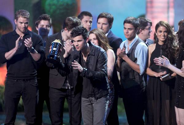 The cast of 'The Twilight Saga: Eclipse' photographed on stage while accepting the Best Movie award at the 2011 MTV Movie Awards in Los Angeles.