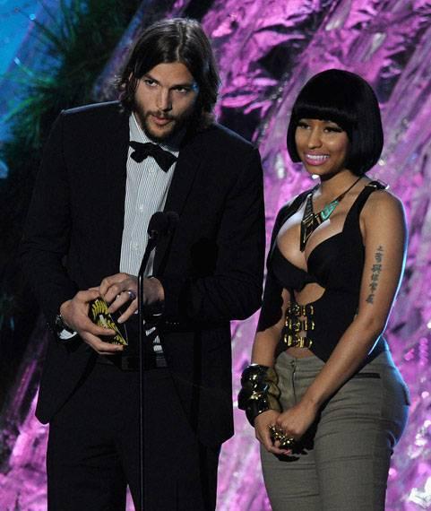 Ashton Kutcher and Nicki Minaj photographed on stage while presenting the Best Female Performance award at the 2011 MTV Movie Awards.