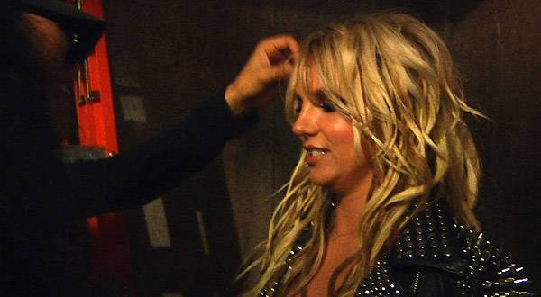 Britney's hair gets a last-minute touch-up on the set of her 'Till the World Ends' video.