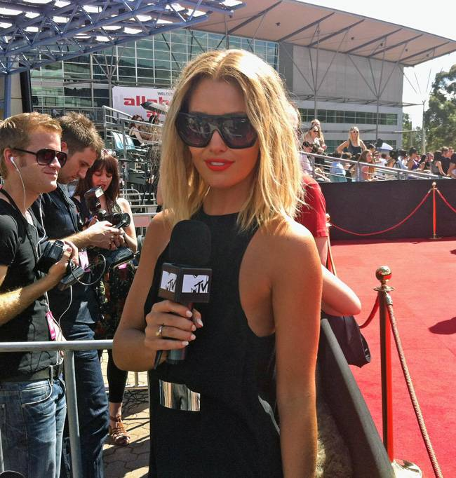 Erin McNaught reporting on the red carpet at the 25th ARIA Awards.