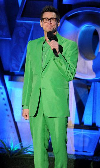 Jim Carrey photographed on stage while introducing the Foo Fighters performance at the 2011 MTV Movie Awards.