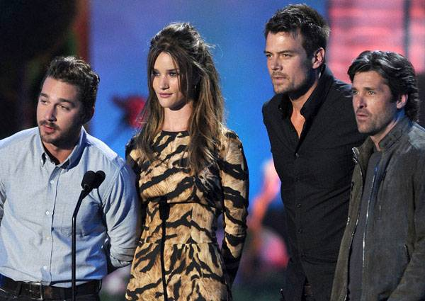 The cast of 'Transformers: Dark of the Moon,' including Shia LaBeouf, Rosie Huntington-Whiteley, Josh Duhamel and Patrick Dempsey, photographed on stage while presenting the Best Fight award at the 2011 MTV Movie Awards.