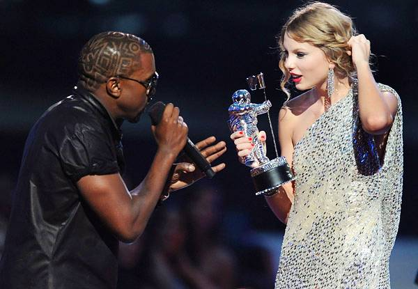 2009 - Kanye West welcomes Taylor Swift to heartbreak at the 2009 MTV Video Music Awards at Radio City Music Hall in New York City.