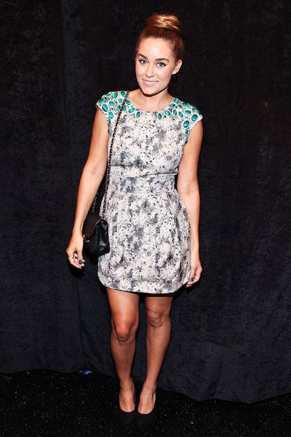 Lauren Conrad poses for a photo backstage at the Lela Rose show during Spring 2013 Mercedes-Benz Fashion Week at The Studio Lincoln Center on September 9, 2012 in New York City.