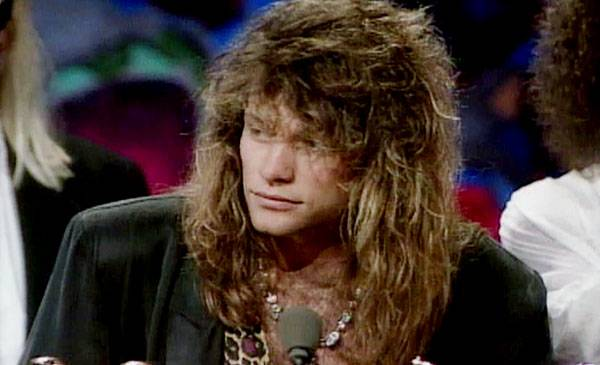 1991 - Bon Jovi peers out from under an otter as he receives the Michael Jackson Video Vanguard Award for 1991.