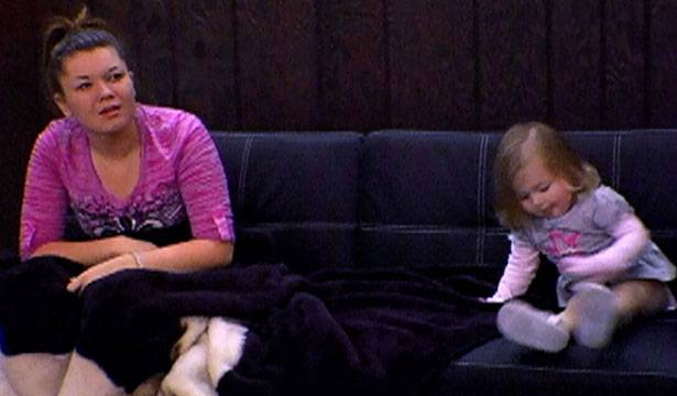 Amber and Leah relax on the couch after a busy day.