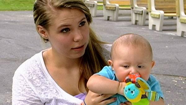 Kailyn and baby Isaac play at the park.