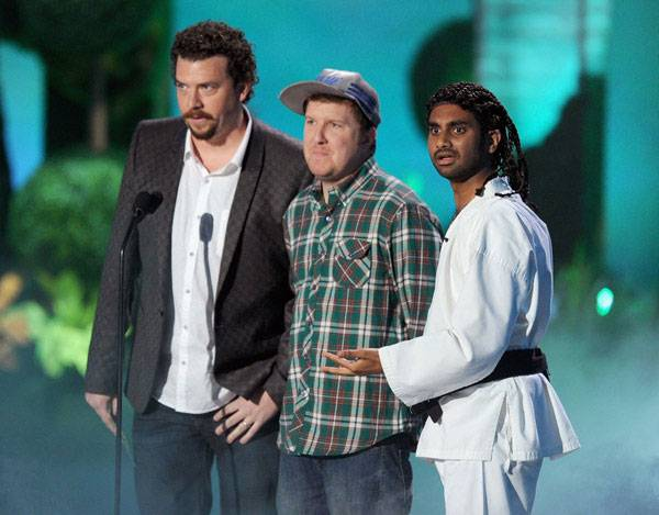Danny McBride, Nick Swardson and Aziz Ansari photographed on stage while presenting the Best Jaw Dropping Moment award at the 2011 MTV Movie Awards.