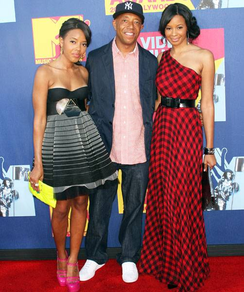 'Daddy's Girls' stars Vanessa and Angela Simmons are all grown up as they stand next to their uncle Russell Simmons at the 2008 Video Music Awards.