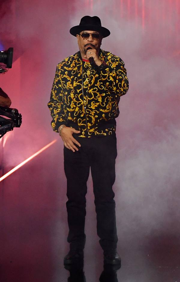 Ice-T wears a cool bomber jacket onstage at the 2019 VMAs.