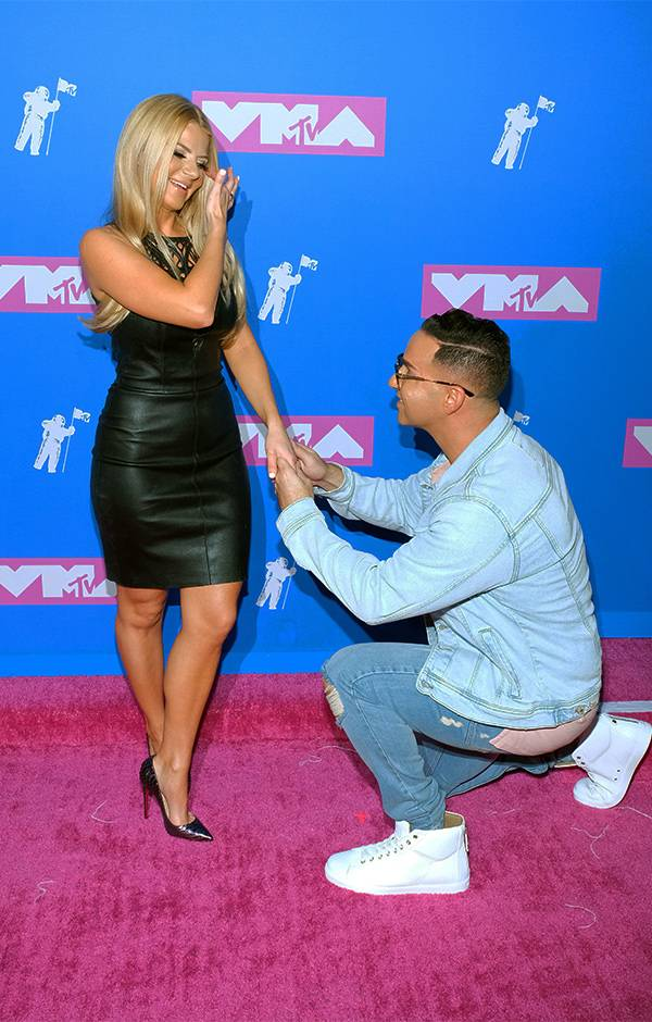 """""""Jersey Shore"""" star Mike The Situation reenacted his proposal to his fiance, Lauren Pesce, on the 2018 VMAs red carpet."""