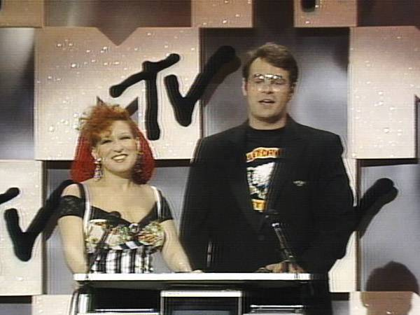 Actress, singer and diva Bette Midler joined funnyman Dan Aykroyd on stage to kick off the first-ever VMA show with a bang in 1984. (MTV)
