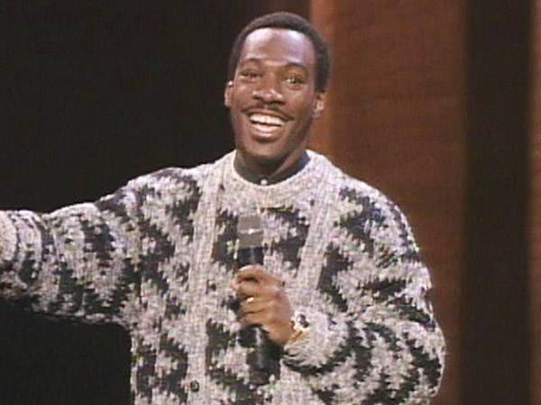 Comedian Eddie Murphy proved to be an over-the-top host at the 1985 VMAs by strolling through women's bathrooms and even taking to the streets to find a co-host. (MTV)