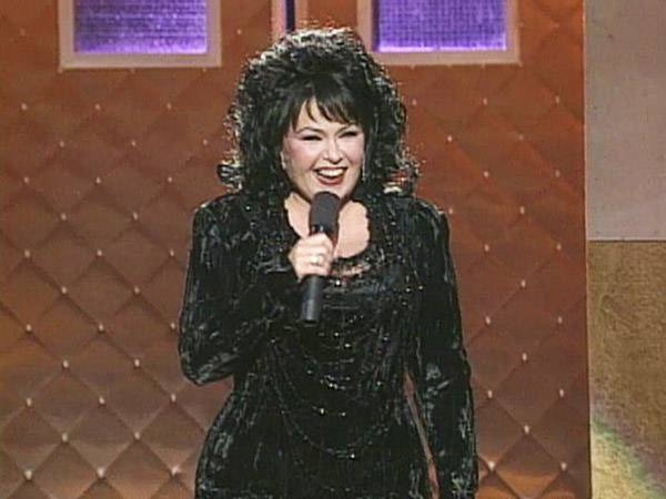 """Comedienne Roseanne Barr made VMA history by being the first female to host an entire show in 1994 and also marked the beginning of """"trailer park chic."""" (MTV)"""