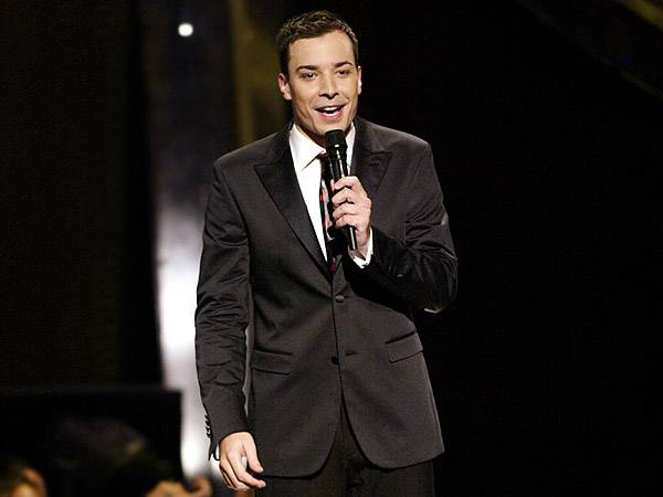 In 2002, MTV opted for the fresh-faced, boy-next-door Jimmy Fallon to host the VMAs and let guests like Triumph the Insult Comic Dog and Eminem do the insulting for him. (Getty Images)