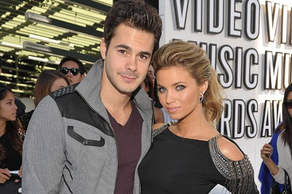 'The Hard Times of RJ Berger' stars Jayson Blair and Amber Lancaster move in close for a camera snap on the red carpet before the 2010 show.