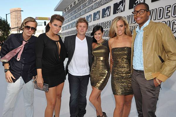 The 'Real World: New Orleans' cast members color coordinate in black and gold on the 2010 carpet.