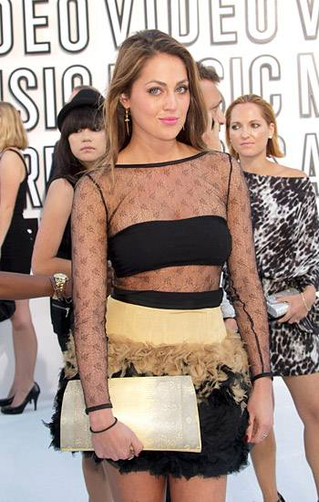 Former 'City' star Roxy Olin rocks a sheer feathered dress on the 2010 VMA red carpet.