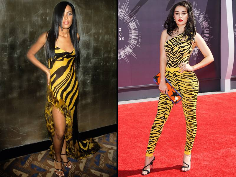 Fashion icon Aaliyah made a memorable statement at the 2000 VMAs, wearing a yellow zebra print dress and strappy heel. Fourteen years later, pop star Charli XCX brought yellow zebra print back to the carpet, this time in a one-piece pant suit.