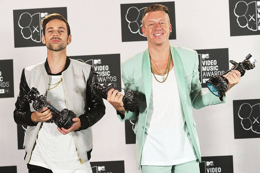 Super producer Ryan Lewis and his hip-hop partner in crime Macklemore show they've come a long way from shopping in thrift shops as they strike a pose with their hard-earned 2013 VMA trophies.