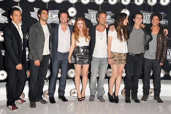 The cast of 'Teen Wolf' take the pack mentality to a whole new level as they casually coordinate their 2011 VMA red carpet wear.