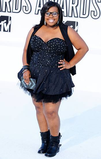 'Glee' star Amber Riley rocks an outfit that is the perfect blend of femininity and toughness: an embellished black mini dress and hard core moto boots at the 2010 VMAs.