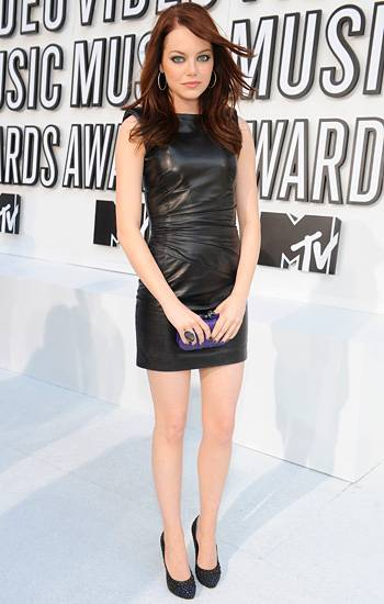 Superstar comedienne Emma Stone goes punk rock pretty in a black leather mini dress and studded pumps at the 2010 VMAs.