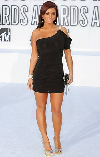 """Jenni """"JWOWW"""" Farley ditches her usual beachwear for a body-hugging black mini that shows off the tan in her GTL routine at the 2010 VMAs."""