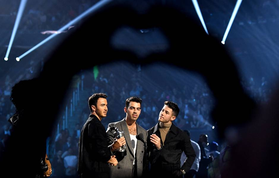Jonas Brothers accept the VMA for Best Pop.