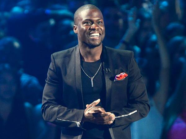Kevin Hart's epic hosting gig of the 2012 show included a serious stage dive, dancing 'Gangnam Style' with Psy himself, and plenty of off-the-cuff jokes in between. (Getty Images)