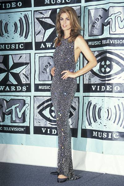 Decked out in sparkles and bling at the 1991 MTV Video Music Awards, Cindy Crawford of 'House of Style' proves why she's the brightest shining star.