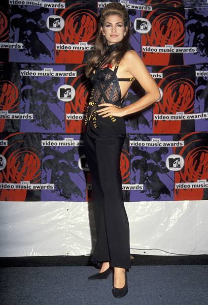 Stunning in a black lace corset, 'House of Style' host Cindy Crawford leaves little to the imagination at the 1992 MTV Video Music Awards.