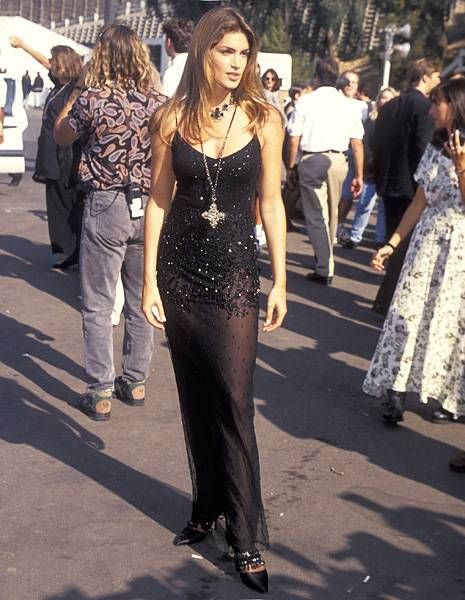 Top model Cindy Crawford of 'House of Style', donning a sheer sparkling maxi, strikes a pose before the 1993 MTV Video Music Awards.