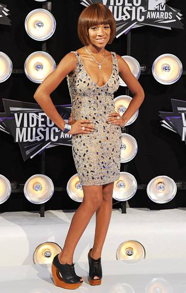 Lil Mama steps from behind the judge's table of 'America's Best Dance Crew' and shines front and center on the red carpet at the 2011 MTV Video Music Awards.