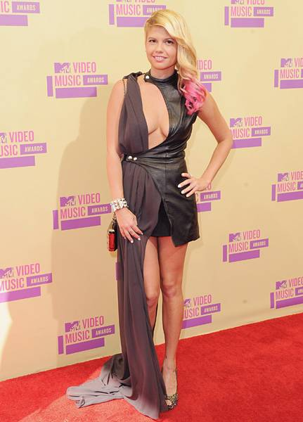 'Ridiculousness' star Chanel West Coast turns heads with a plunging neckline and a long-meets-short hemline on the red carpet at the 2012 Video Music Awards.