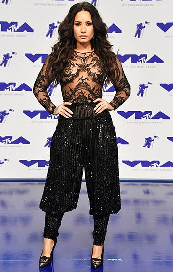 On the 2017 VMA red carpet, Demi Lovato paired a sheer lace top with sequin harem pants for a look that screams glam.
