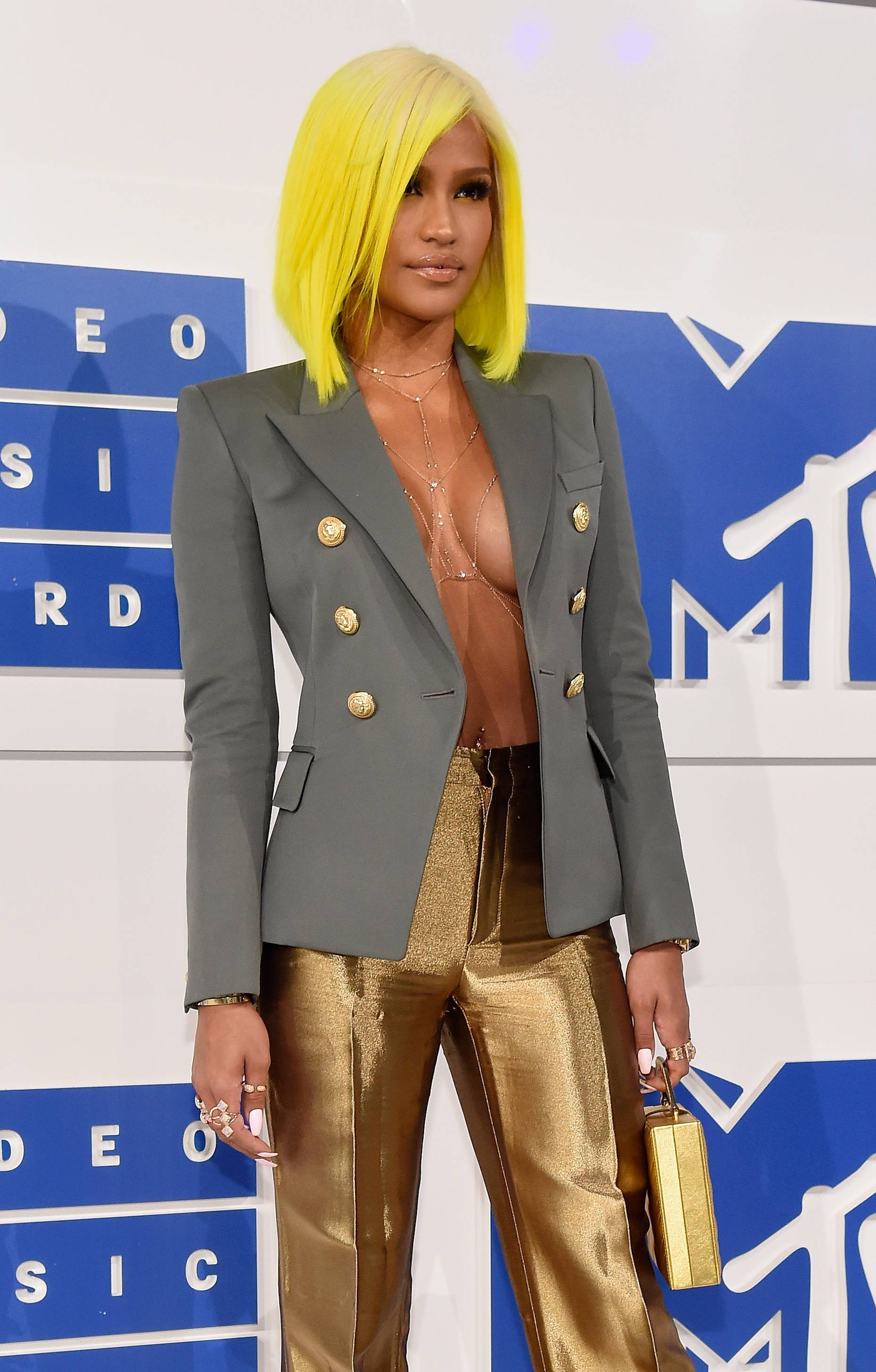 The only thing that could distract us from Cassie's neon green hair and shimmering gold pants is her missing top (which no one actually misses) at the 2016 VMAs.