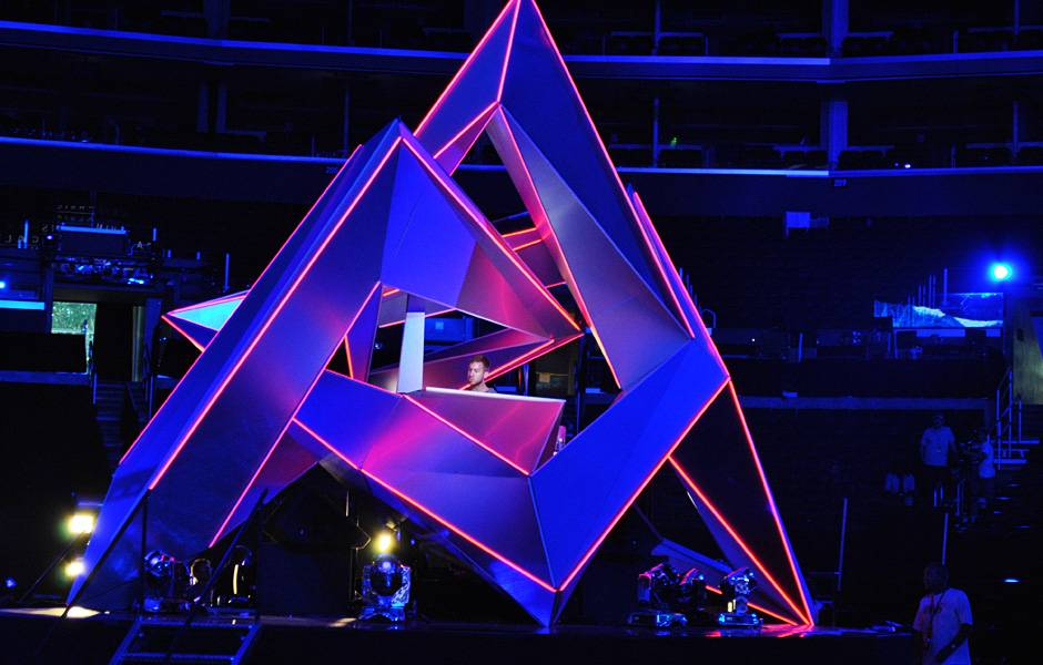 Calvin Harris spins the hits from within a geometric mountain in the middle of the Staples Center at the 2012 show.