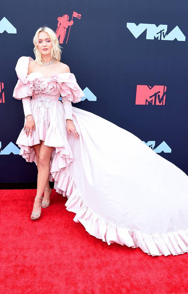 Swedish singer-songwriter Zara Larsson's flowing dress makes a statement on the red carpet.