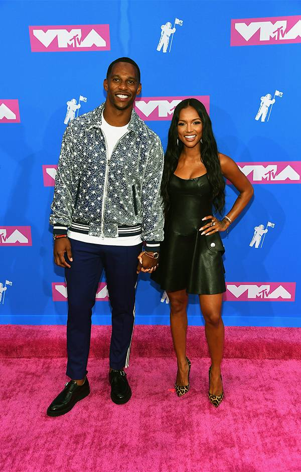 Actress Karrueche Tran and football star Victor Cruz showed their love by sweetly holding hands on the 2018 VMAs red carpet.
