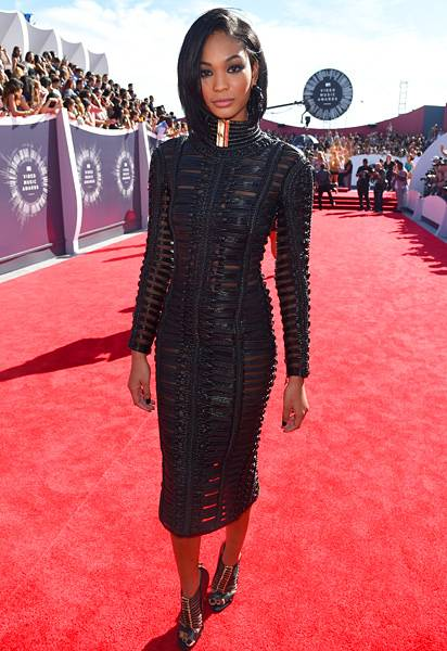 Chanel Iman is runway ready for the 2014 VMA red carpet, modelling a heavy black leather Balmain frock.