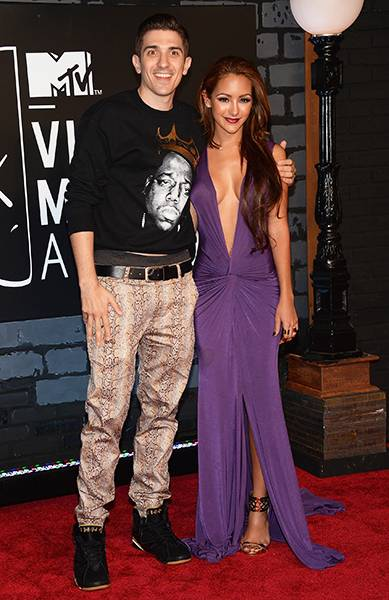'Guy Code' and 'Girl Code' stars Andrew Shulz and Melanie Iglesias are the perfect red carpet couple at the 2013 MTV Video Music Awards.