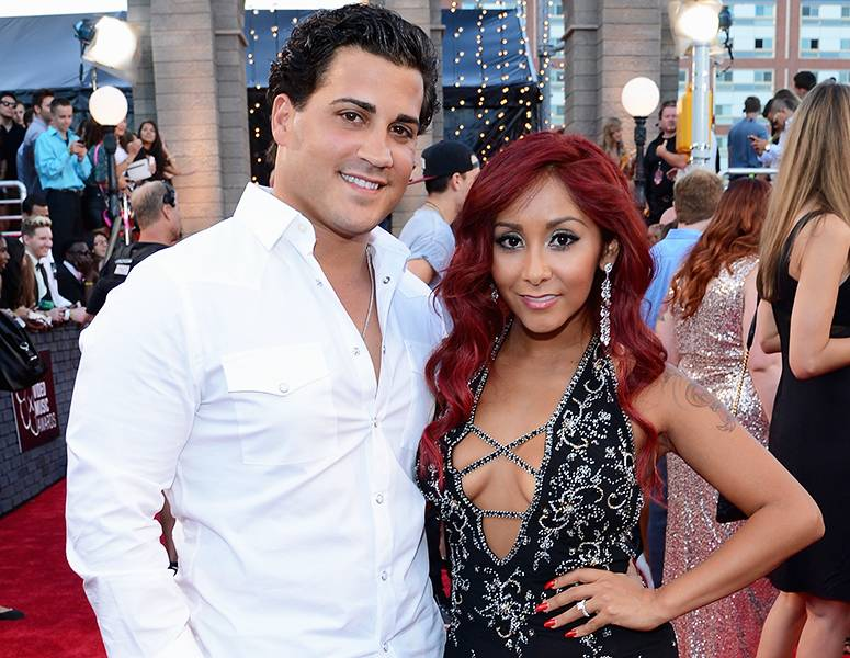 """'Jersey Shore' it-couple Jionni Lavalle and Nicole """"Snooki"""" Polizzi look more glam than guido while posing on the 2013 MTV Video Music Awards red carpet."""