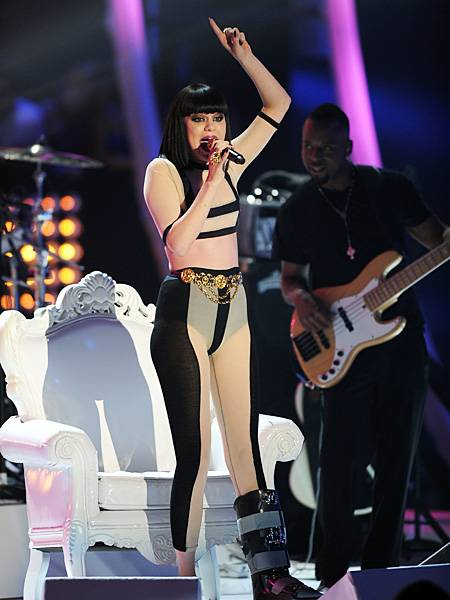 Jessie J makes the most of a bedazzled boot and negative space with a body baring jumpsuit at the 2011 VMAs.