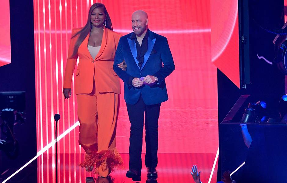 Queen Latifah and John Travolta present onstage at the 2019 VMAs.