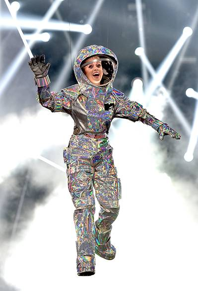 Katy Perry lands on stage dressed as the infamous Moonperson to host the 2017 VMAs. Her opening monologue, pop-culture hitting outfits, and closing performance alongside Nicki Minaj were out of this world! (Getty Images)