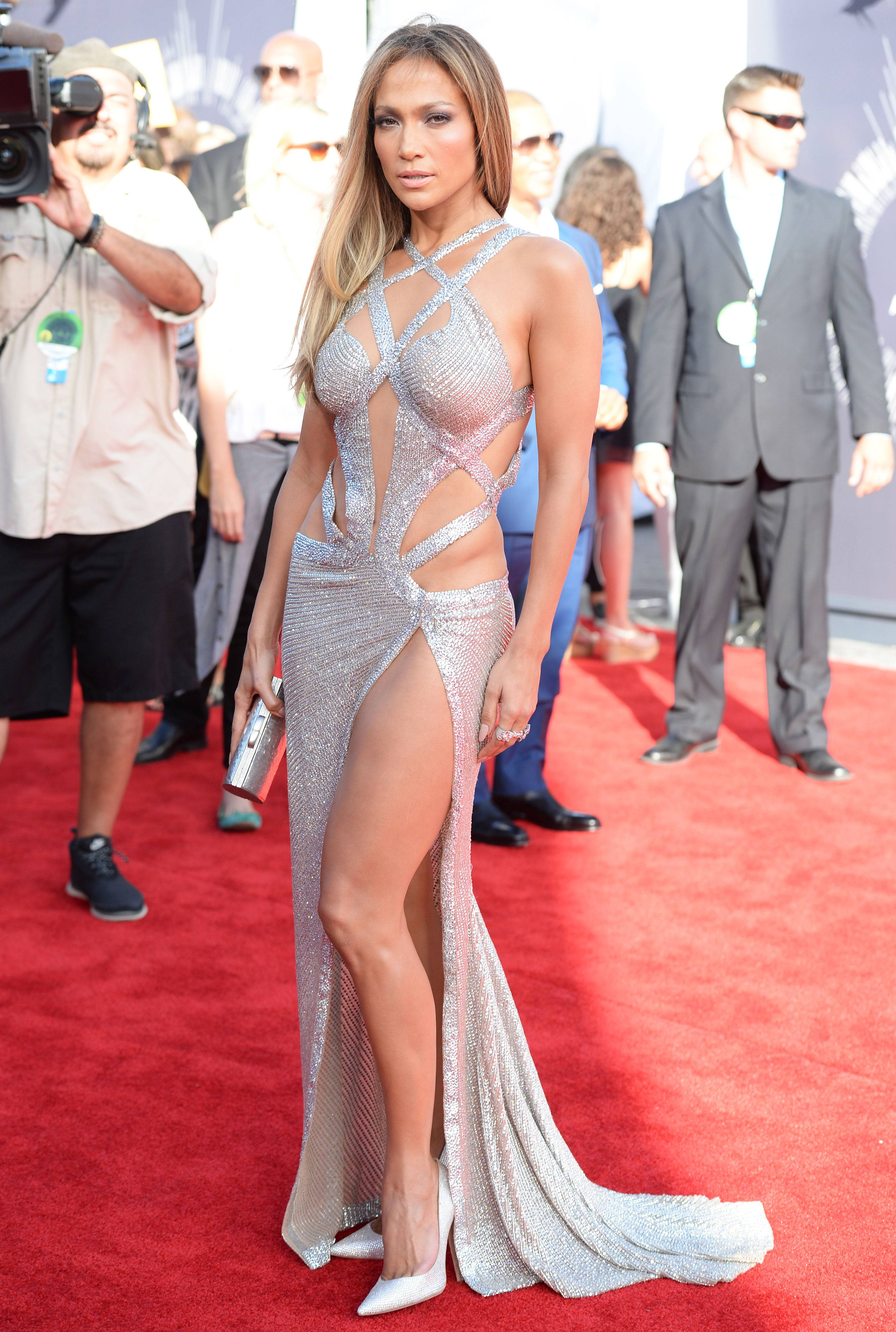 J.Lo glows on the 2014 VMA red carpet in a thigh-high slit dress with strappy, lucid beading.
