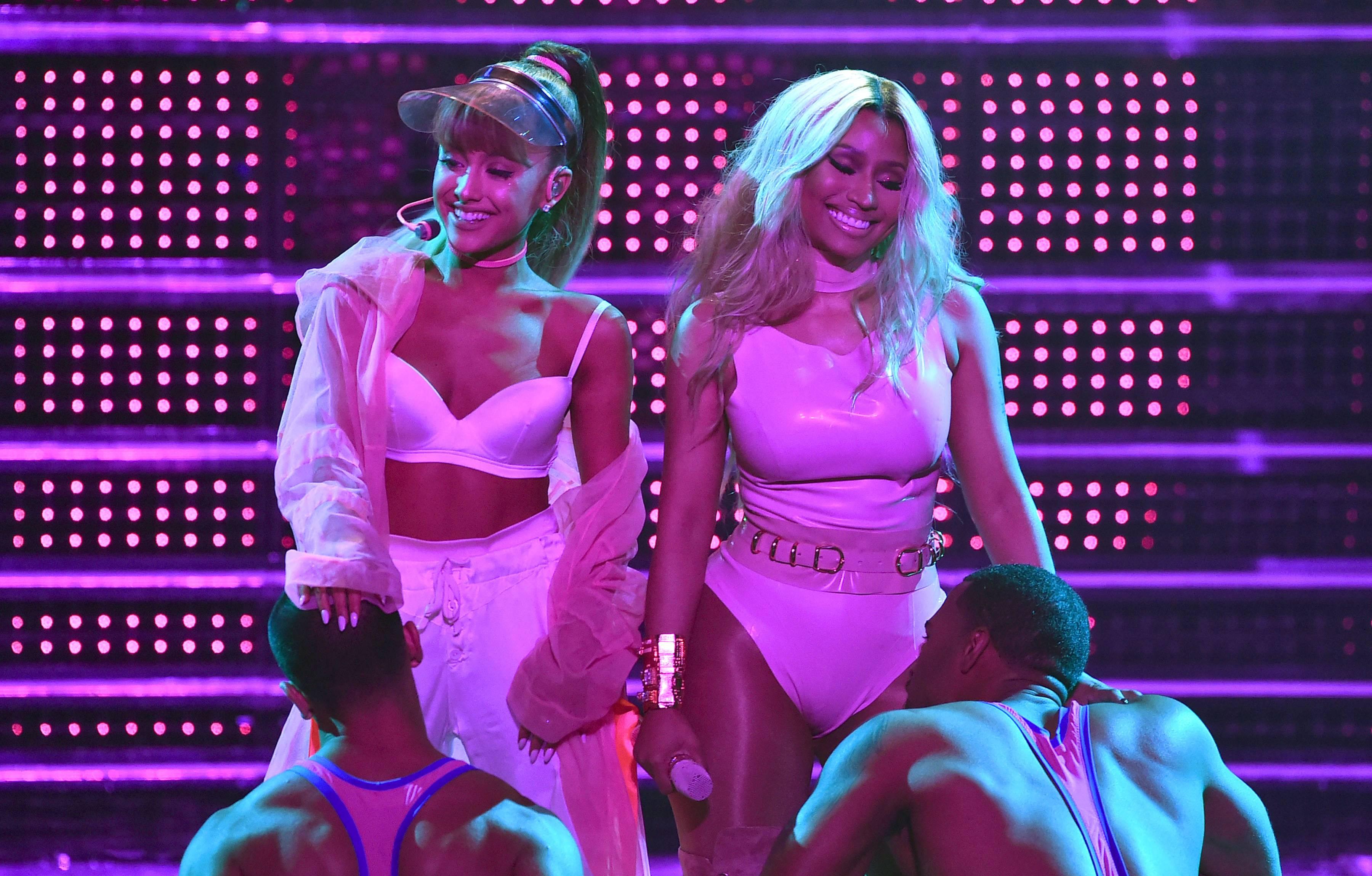 "Pink ladies Ariana Grande and Nicki Minaj got us moving ""Side to Side"" during their energetic performance at the 2016 VMAs."