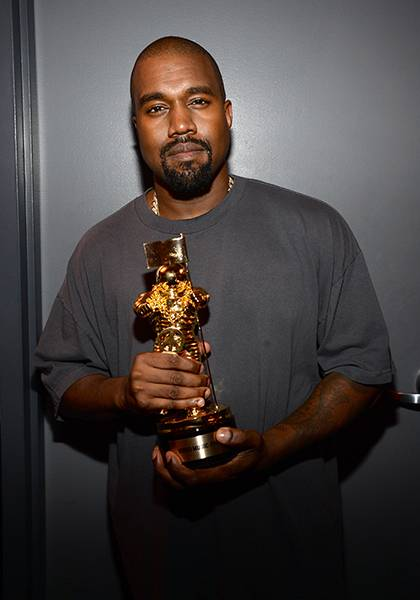 2015 Video Vanguard recipient and future presidential candidate Kanye West poses with his all-gold Moonman commemorating his illustrious career in music.