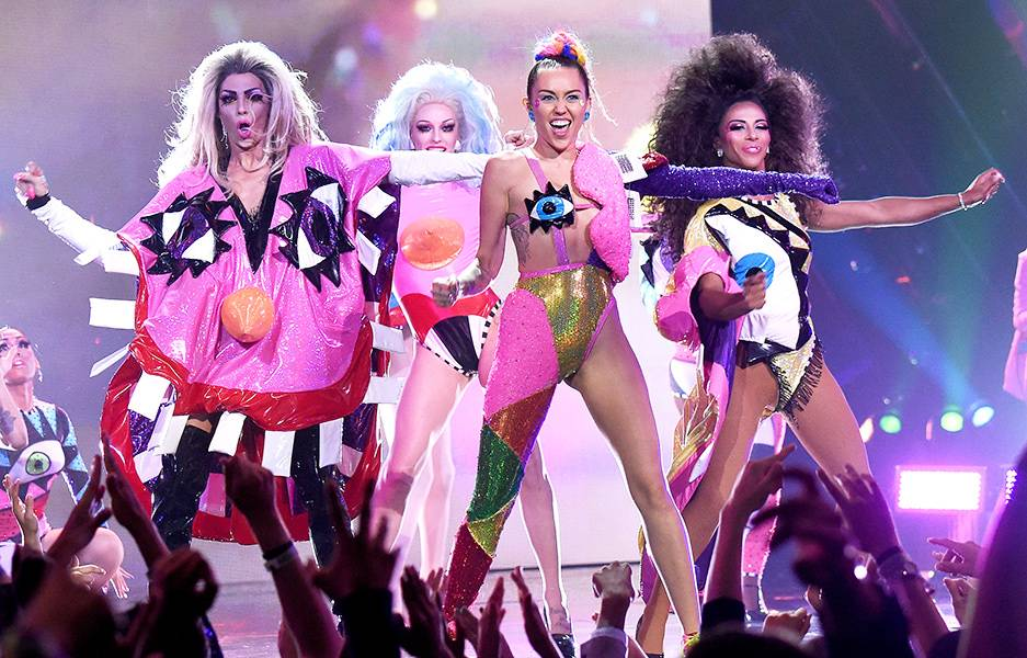 Everything about Miley Cyrus' technicolor finale performance at the 2015 Video Music Awards was a total jaw-dropper. From the colorful costumes to her backup dancers, it was one of the biggest surprises of the night.